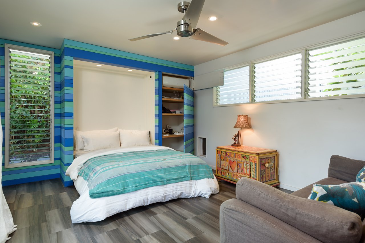 Bedroom, Bed, Porcelain Tile Floor, and Recessed Lighting Guest Bedroom in main house with murphy bed pulled down and hidden cabinets open  A Modern 1954 Plantation Style Home on Maui