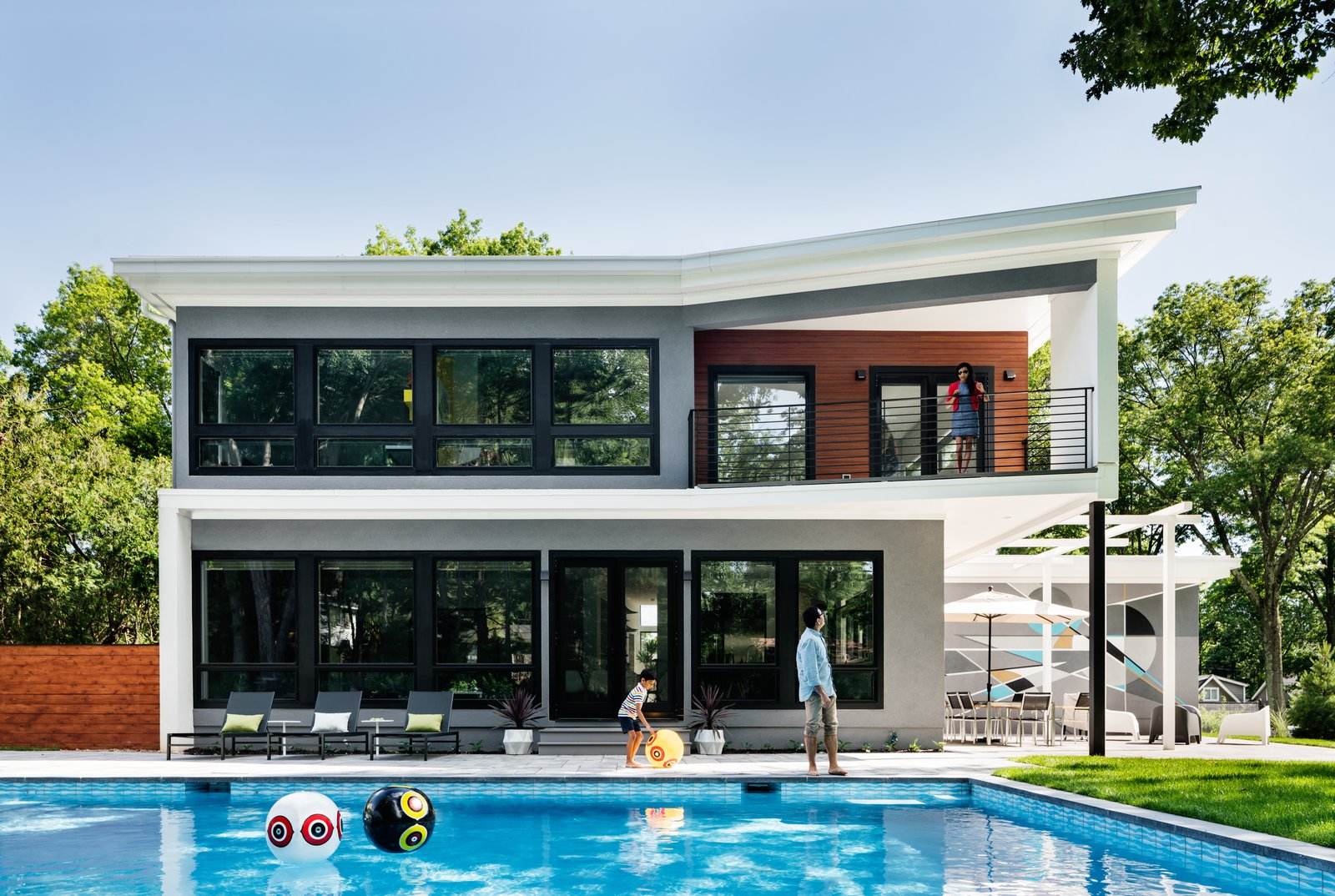 Outdoor, Back Yard, Swimming, Hardscapes, Salt Water, Concrete, Large, Large, Concrete, Pavers, Horizontal, and Wood Rear facade, with maximum glazing and balconies to maximize daylight, views and social interaction.  Best Outdoor Horizontal Swimming Photos from Roslyn Road Residence