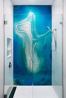 Custom resin panels, designed specifically for the proportion of the shower.