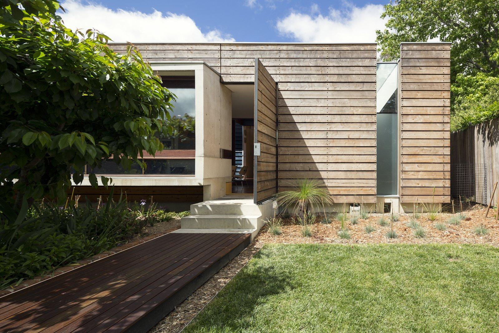 Exterior, House Building Type, Metal Roof Material, Wood Siding Material, Concrete Siding Material, Glass Siding Material, and Flat RoofLine Northern elevation; Australian Cypress, concrete, and river red gum.  Kihilla by James Thomas Barclay
