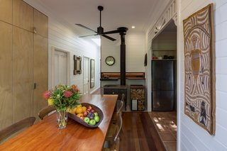 Dining room table and restored slow combustion cook top at centre of plan.