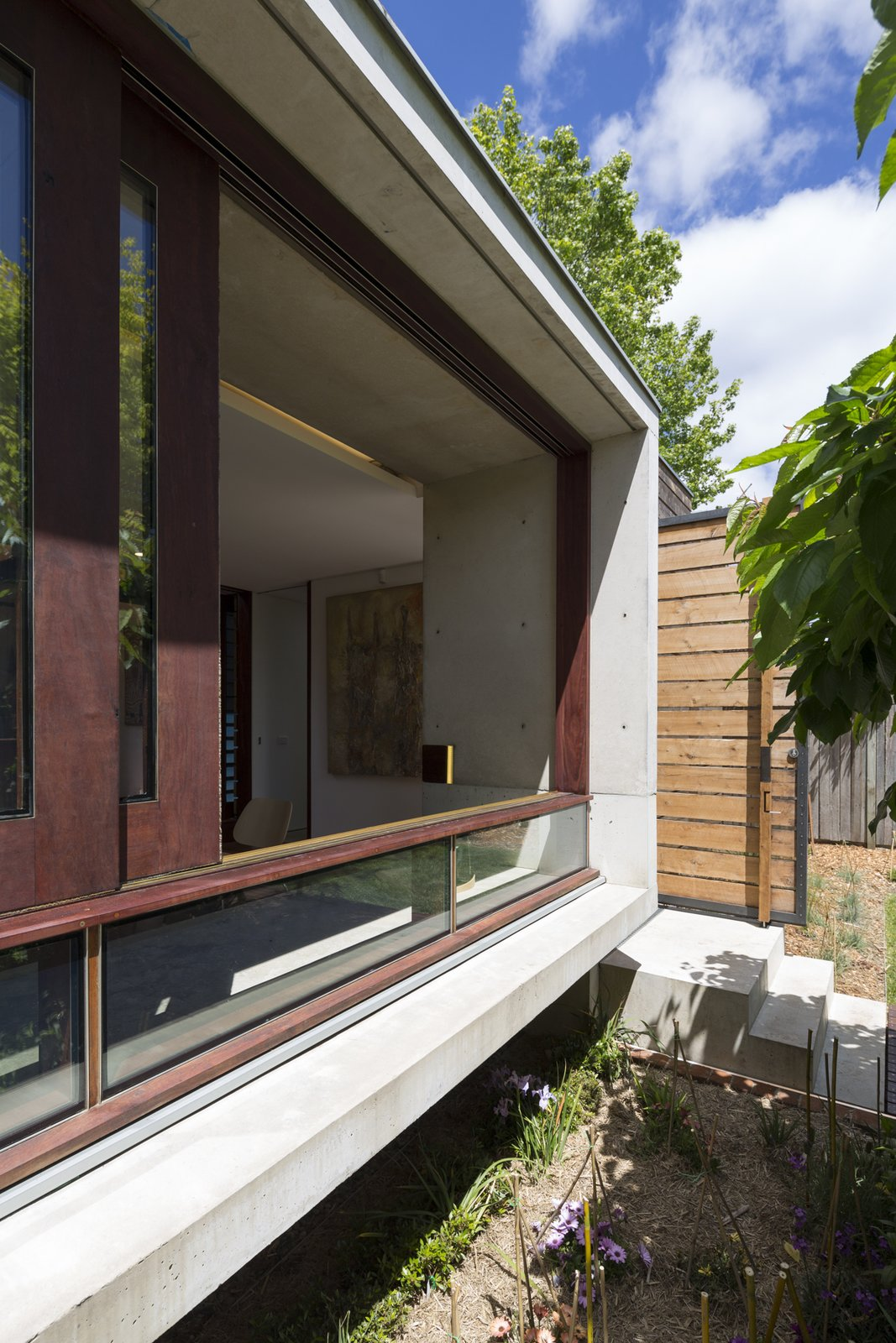 Exterior, House Building Type, Metal Roof Material, Wood Siding Material, Concrete Siding Material, Glass Siding Material, and Flat RoofLine Custom river red gum sliding windows and australian cypress door.  Kihilla by James Thomas Barclay