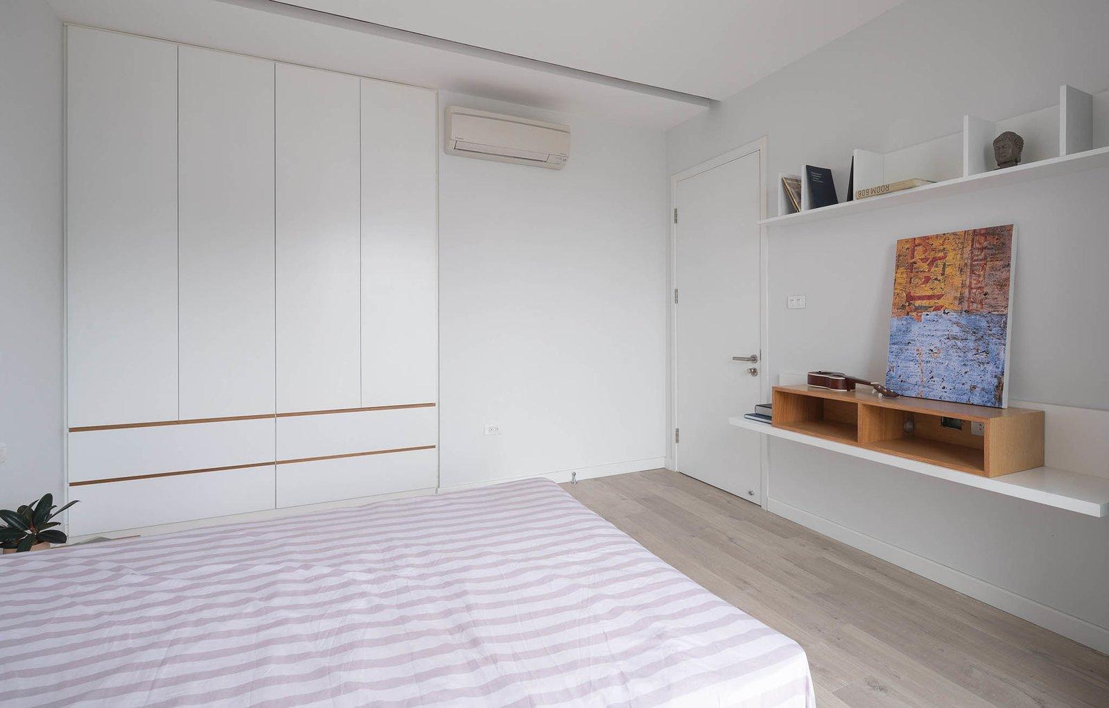 Bedroom, Light Hardwood Floor, Bed, and Ceiling Lighting bedroom  A.D02