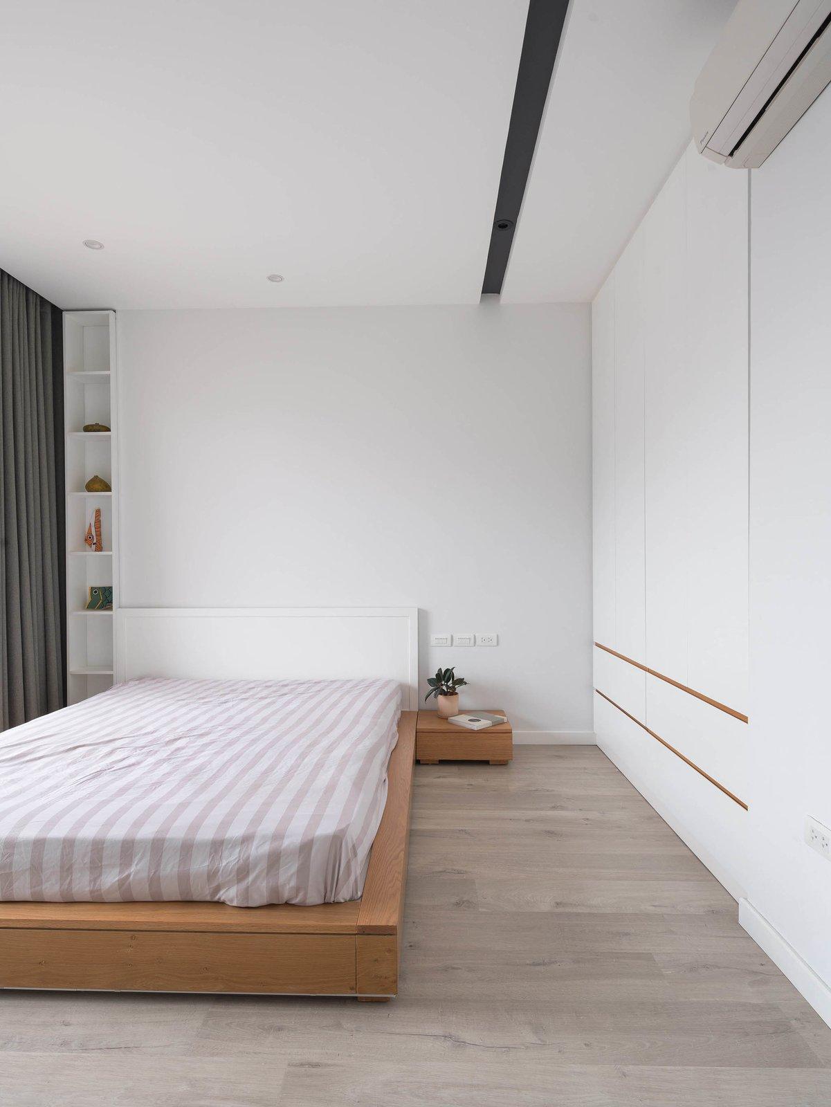 Bedroom, Wardrobe, Ceiling Lighting, Bed, and Light Hardwood Floor bedroom  Best Photos from A.D02