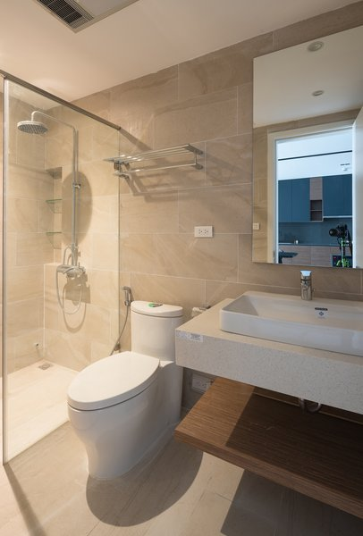 Bath Room, Ceiling Lighting, Ceramic Tile Wall, Ceramic Tile Floor, Enclosed Shower, Tile Counter, One Piece Toilet, and Wall Mount Sink Bathroom  A.D02