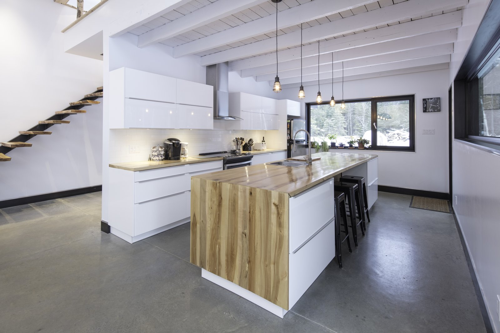 Kitchen, Wood, White, Wood, Concrete, Ceramic Tile, Pendant, Recessed, and Drop In Kitchen, all wood finishes was taken from the forest.  Best Kitchen Wood Wood Drop In Pendant Concrete Photos from Maison Lac Brûlé