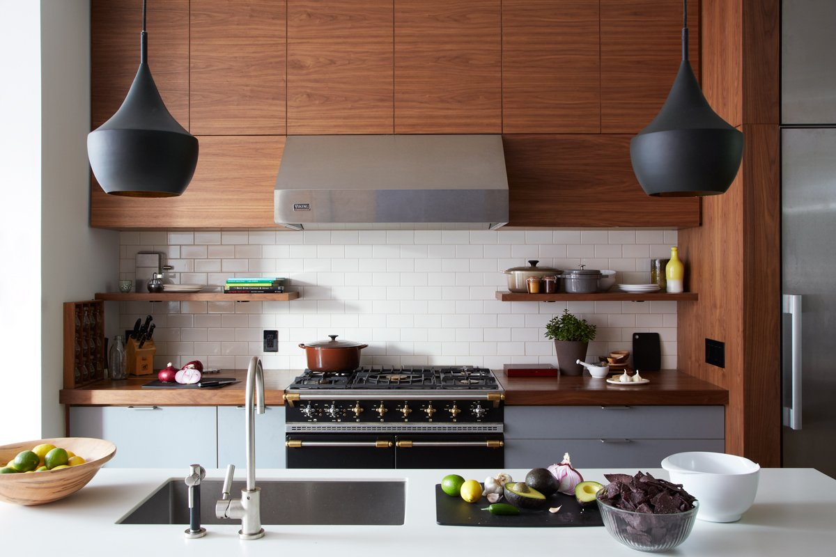 """Kitchen, Refrigerator, Wall Oven, Cooktops, Range, Engineered Quartz Counter, Wood Counter, Wood Cabinet, Ceramic Tile Backsplashe, Range Hood, Subway Tile Backsplashe, Accent Lighting, Pendant Lighting, and Drop In Sink Don't dismiss the kitchen as a modern day parlor. Sarrah Khan of Agencie Architecture & Engineering says, """" Kitchens are modern parlor rooms. In today's homes, kitchens serve a double function of both cooking and entertaining zones.""""  Photo 1 of 17 in What's the Most Overlooked Feature When Planning a Kitchen Renovation? from Williamsburg Rowhouse"""