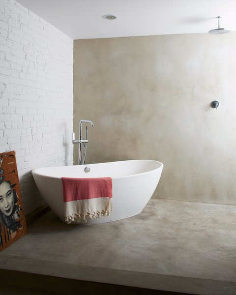 Hand-troweled concrete bathroom