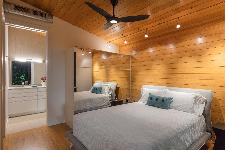Bedroom, Bed, Recessed Lighting, Medium Hardwood Floor, and Night Stands Bedroom  Mike's Hammock by Josh Wynne