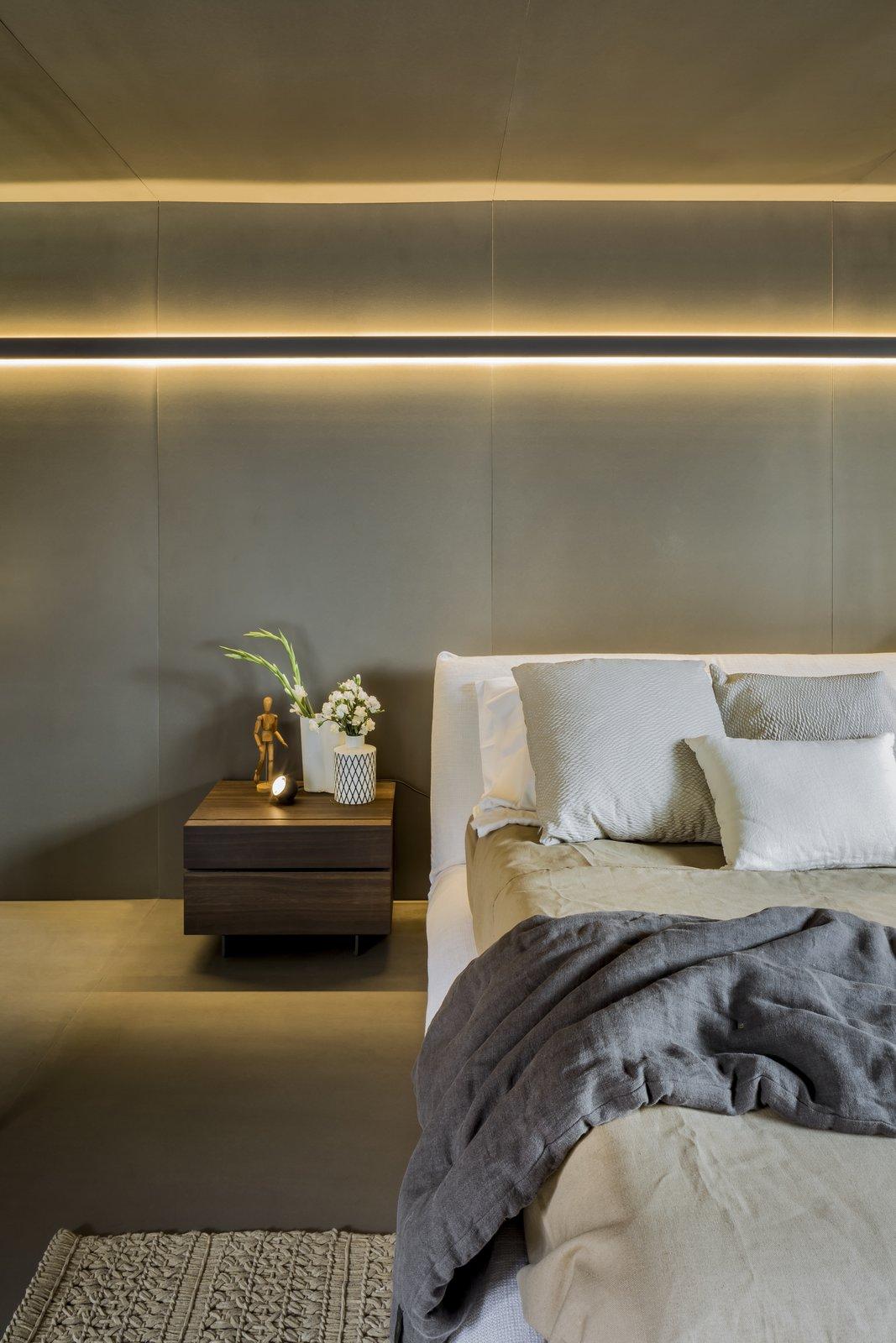 Bedroom, Bed, Wall Lighting, and Concrete Floor SOA Soler Orozco Arquitectos . Casa Molina  Casa Molina by SOA Soler Orozco Arquitectos