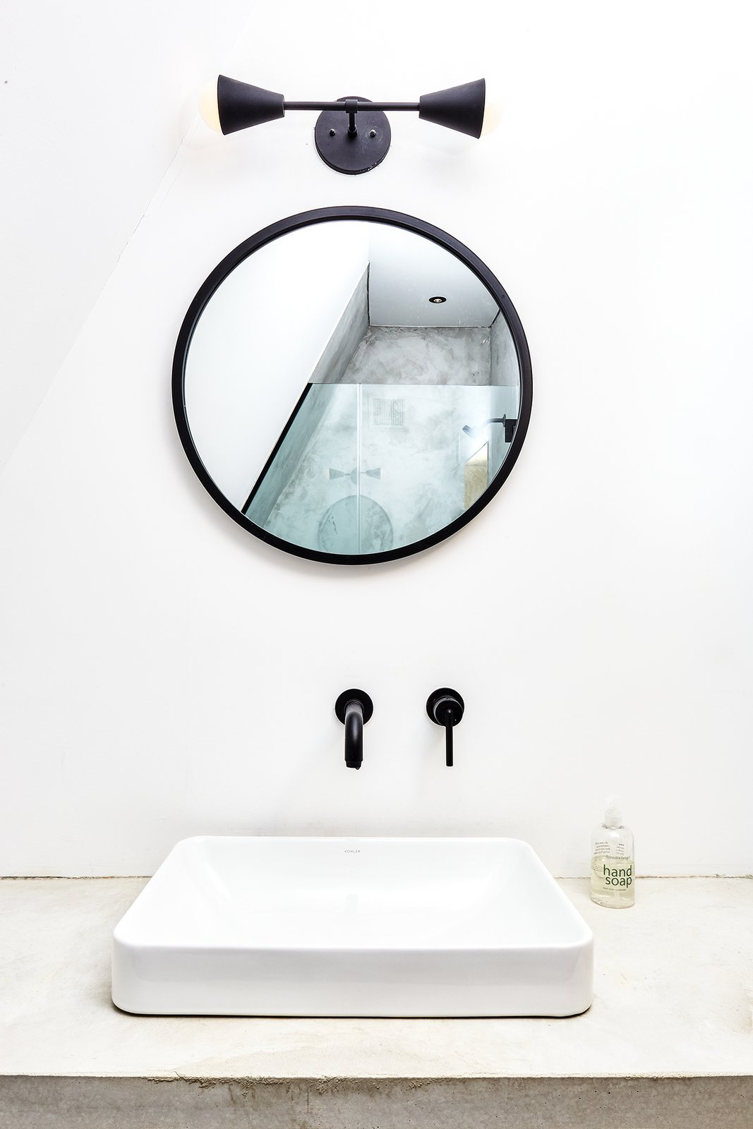 Bath Room, Vessel Sink, Wall Lighting, and Concrete Counter Bath vanity with Kohler sink, matte black fixtures by Delta and Triple Seven Home. Poured in place concrete sink by us.   Best Photos from Lokal A-Frame