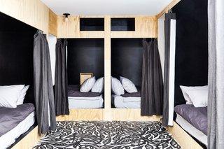 Bunk room in basement with custom artwork on floor by Sean Martorana. Curtains by West Elm.