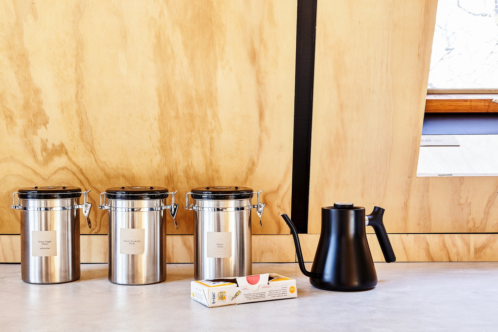 Kitchen, Concrete Counter, and Wood Backsplashe Complementary tea provided. Kettle by Fellow products.   Lokal A-Frame