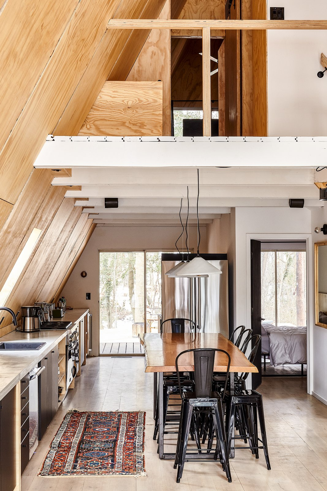 Dining Room, Table, Desk, Pendant Lighting, Storage, Light Hardwood Floor, and Stools Kitchen and loft with live edge dining table/kitchen island by Timberforge Woodworks  Lokal A-Frame