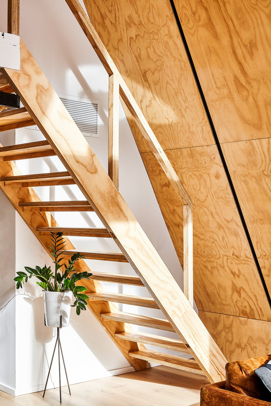 Staircase, Wood Railing, and Wood Tread Custom stair made entirely of matching pine plywood.  Lokal A-Frame