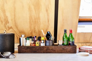 Bar supplies by Art in the Age. Detail of original beam reveal shown painted with matte black milk paint.