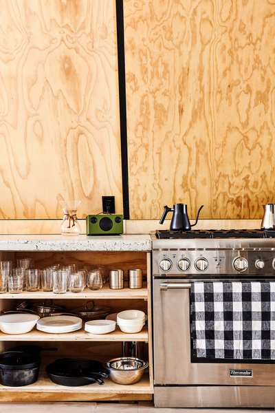 Kitchen, Range, Ceiling, Light Hardwood, Wood, Wood, and Concrete Chef's kitchen detail with open plywood shelves. Range by Thermador  Best Kitchen Wood Ceiling Photos from Lokal A-Frame
