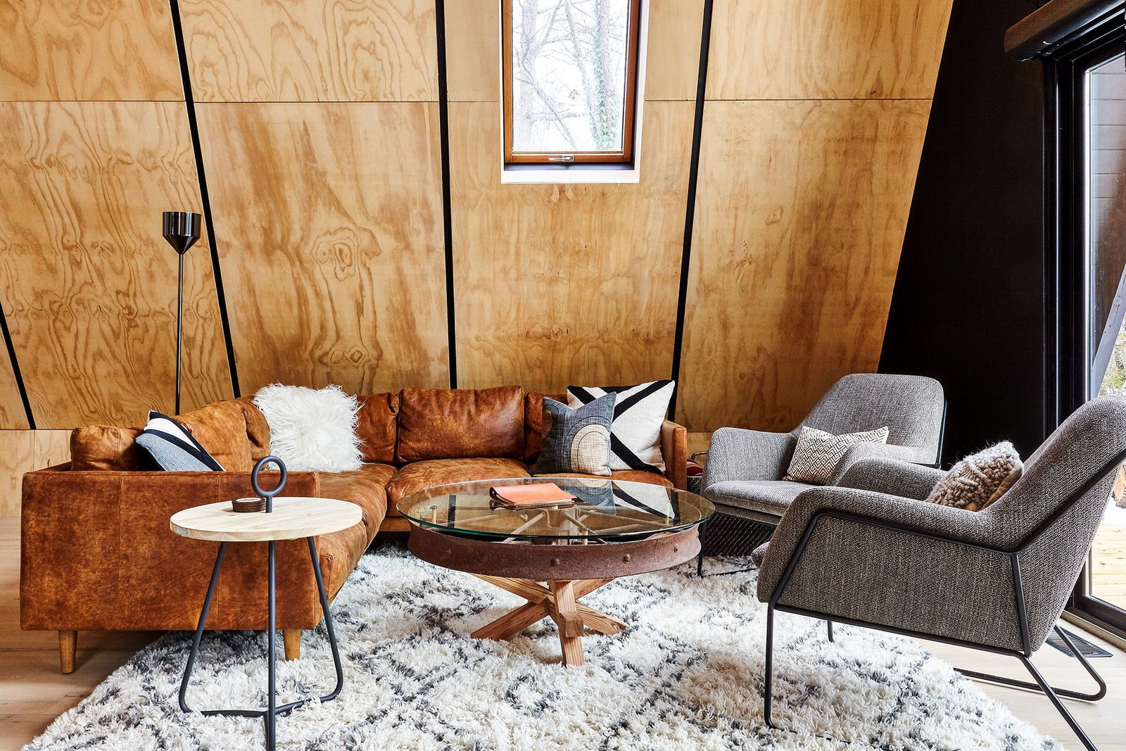 Living, Light Hardwood, Sectional, Coffee Tables, Floor, End Tables, Chair, Lamps, and Rug Living room with furnishings by Article & custom wagon wheel table by Ovuud  Living Light Hardwood Sectional Lamps Photos from Lokal A-Frame
