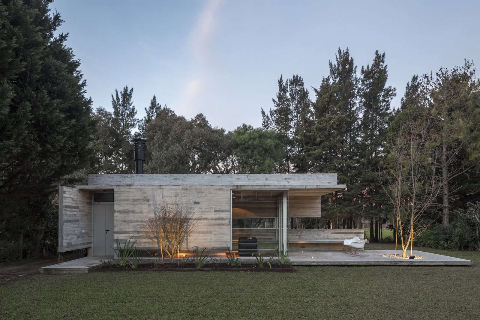 Outdoor, Back Yard, Trees, Grass, Gardens, and Concrete Patio, Porch, Deck Torcuato House Pavilion - Besonías Almeida arquitectos  Best Photos from Torcuato House Pavilion