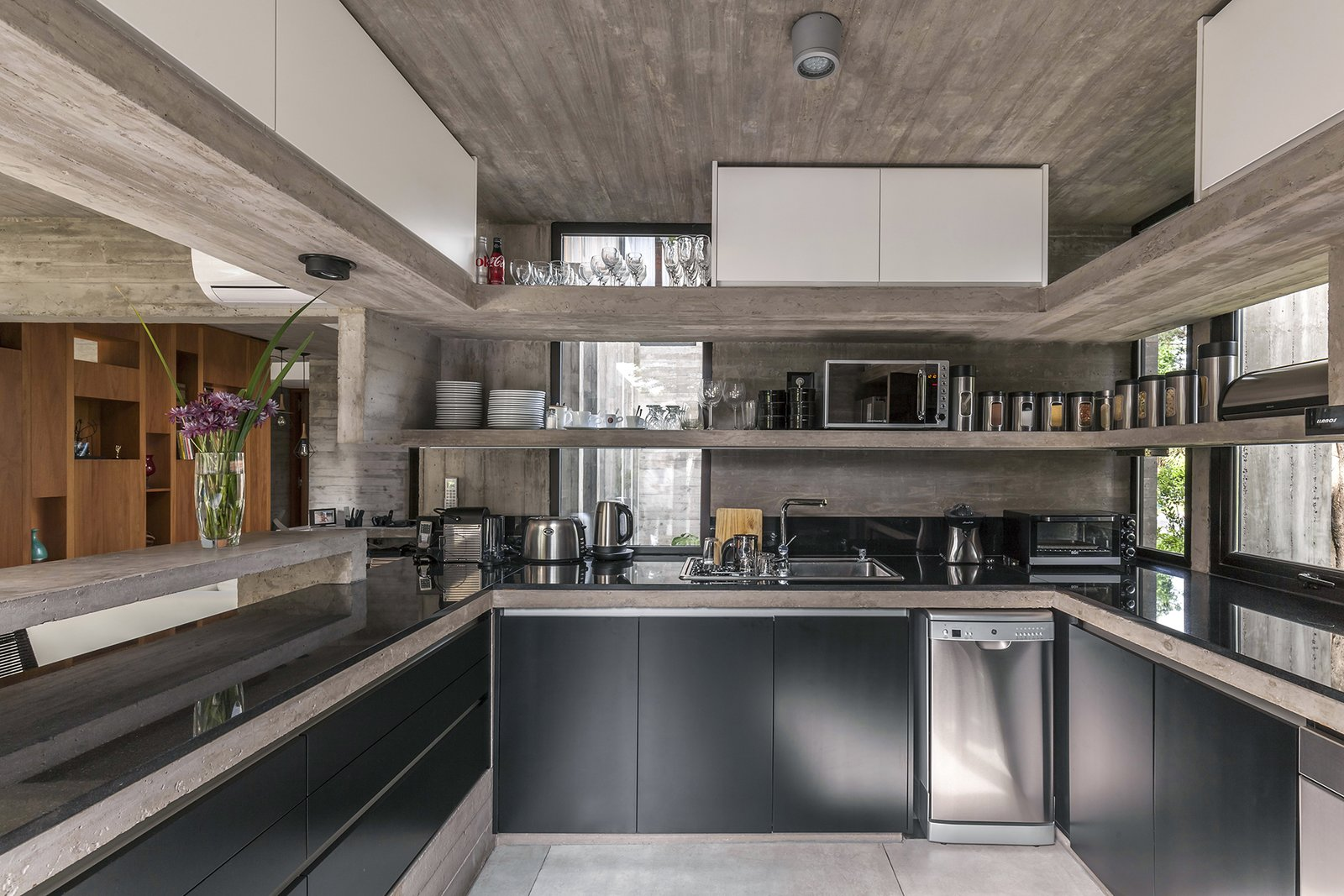 Kitchen, Granite, Laminate, Ceramic Tile, Stone Slab, Concrete, Accent, Undermount, Microwave, and Dishwasher Aranzazu House - Besonías Almeida arquitectos  Best Kitchen Granite Laminate Photos from Aranzazu House
