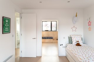 "Built for the couple's twins, the children's bedrooms are a mirror of one another. While each child has their own personalized space, a ""secret"" door within the adjoining room gives the twins the choice to unify the floor into a giant play area."