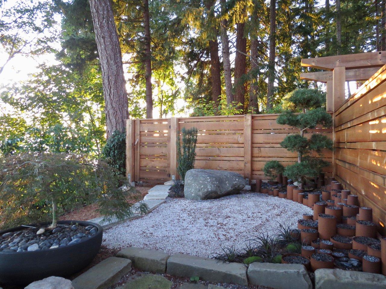 Outdoor, Side Yard, Trees, Shrubs, Grass, Gardens, and Boulders Zen Garden  Cortes Island Custom Blu Prefab by Mark Spevakow