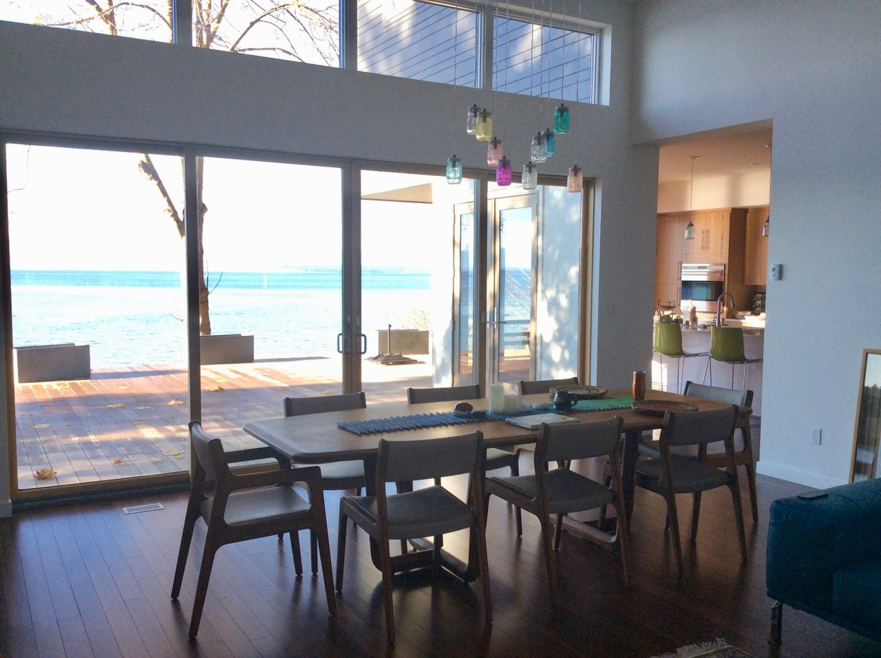 Dining Room, Table, Chair, Pendant Lighting, and Bamboo Floor Breeze Space with Kitchen on the right  Cortes Island Custom Blu Prefab by Mark Spevakow