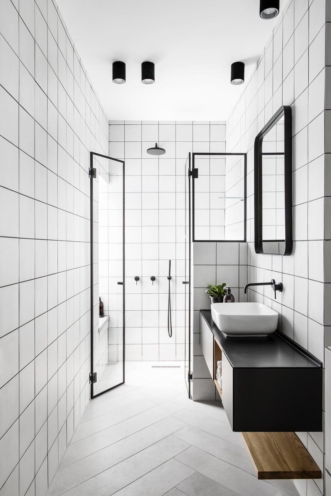 Bath Room Geometric monochrome bathroom.  Nir Am House by Shir Shtaigman