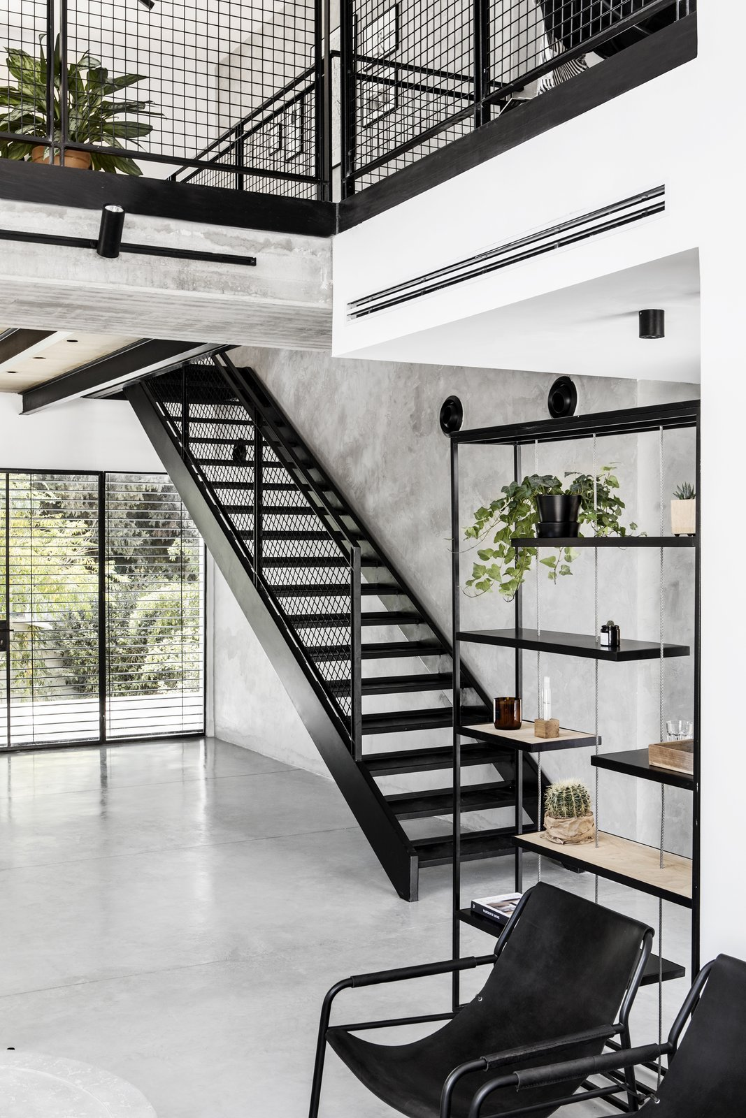 Staircase, Metal Tread, and Metal Railing Metal staircase to the second floor.  Nir Am House by Shir Shtaigman