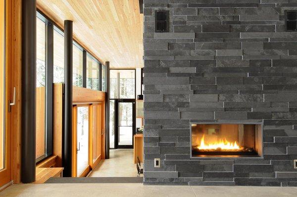 Interior palette: slate fireplace, Douglas fir ceilings, black accents, glass