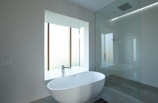 Master bathroom with backlit pop out wind boxes.