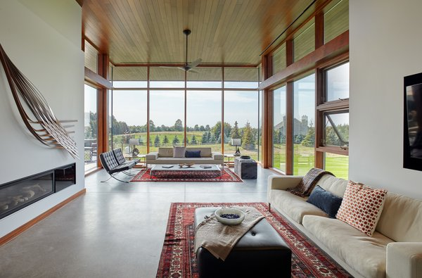 main living room space with custom curtain wall