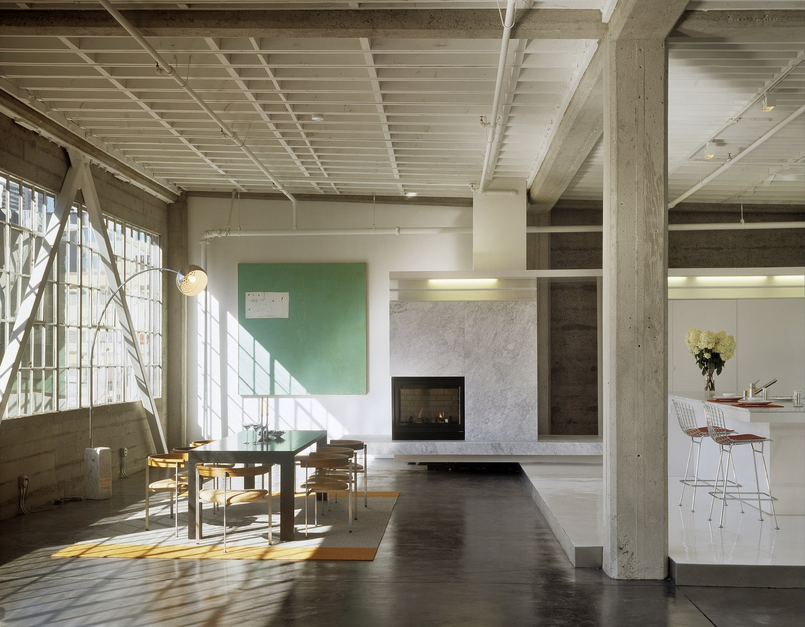 Dining Room, Two-Sided Fireplace, Chair, Bar, Corner Fireplace, Pendant Lighting, Concrete Floor, and Table Dining area  Tehama Grasshopper by Fougeron Architecture