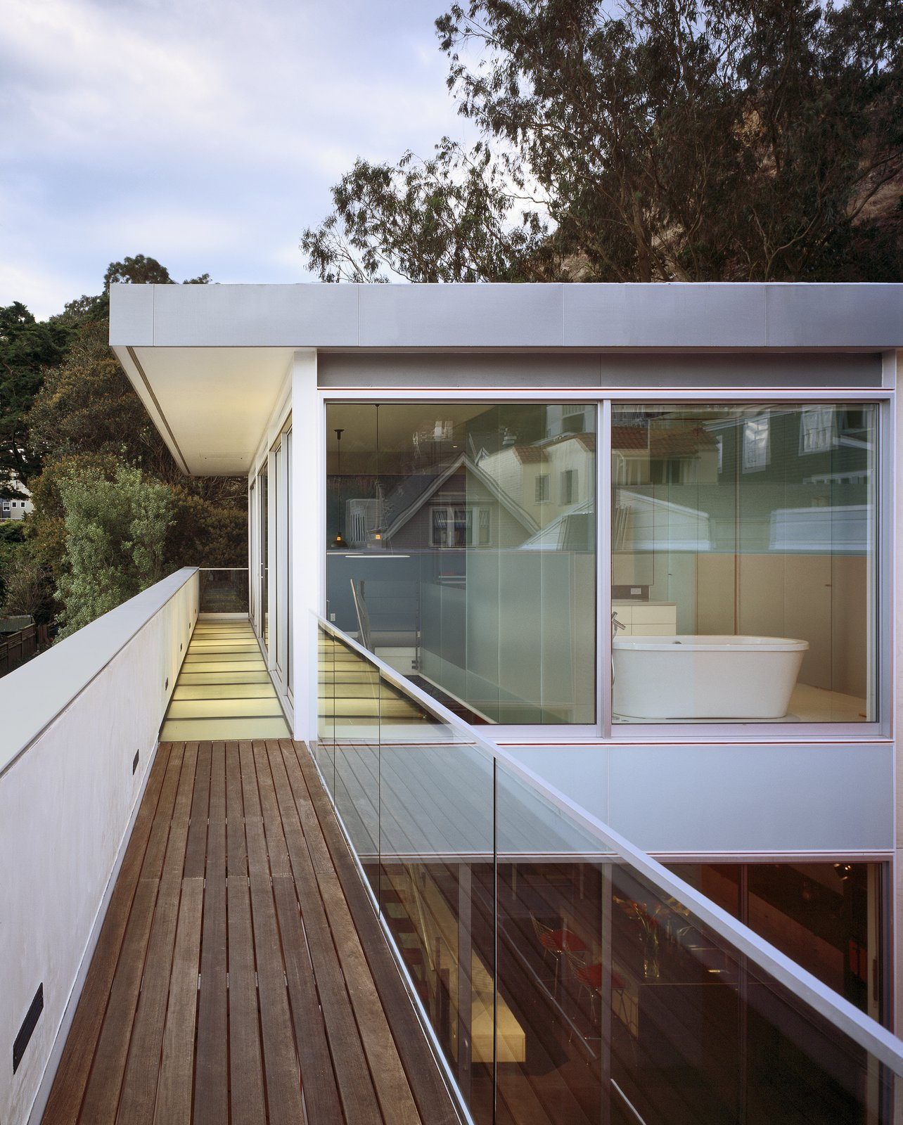 Exterior, Metal Roof Material, Metal Siding Material, House Building Type, Glass Siding Material, and Flat RoofLine Outdoor walkway to the master bedroom  Best Photos from 1532 House