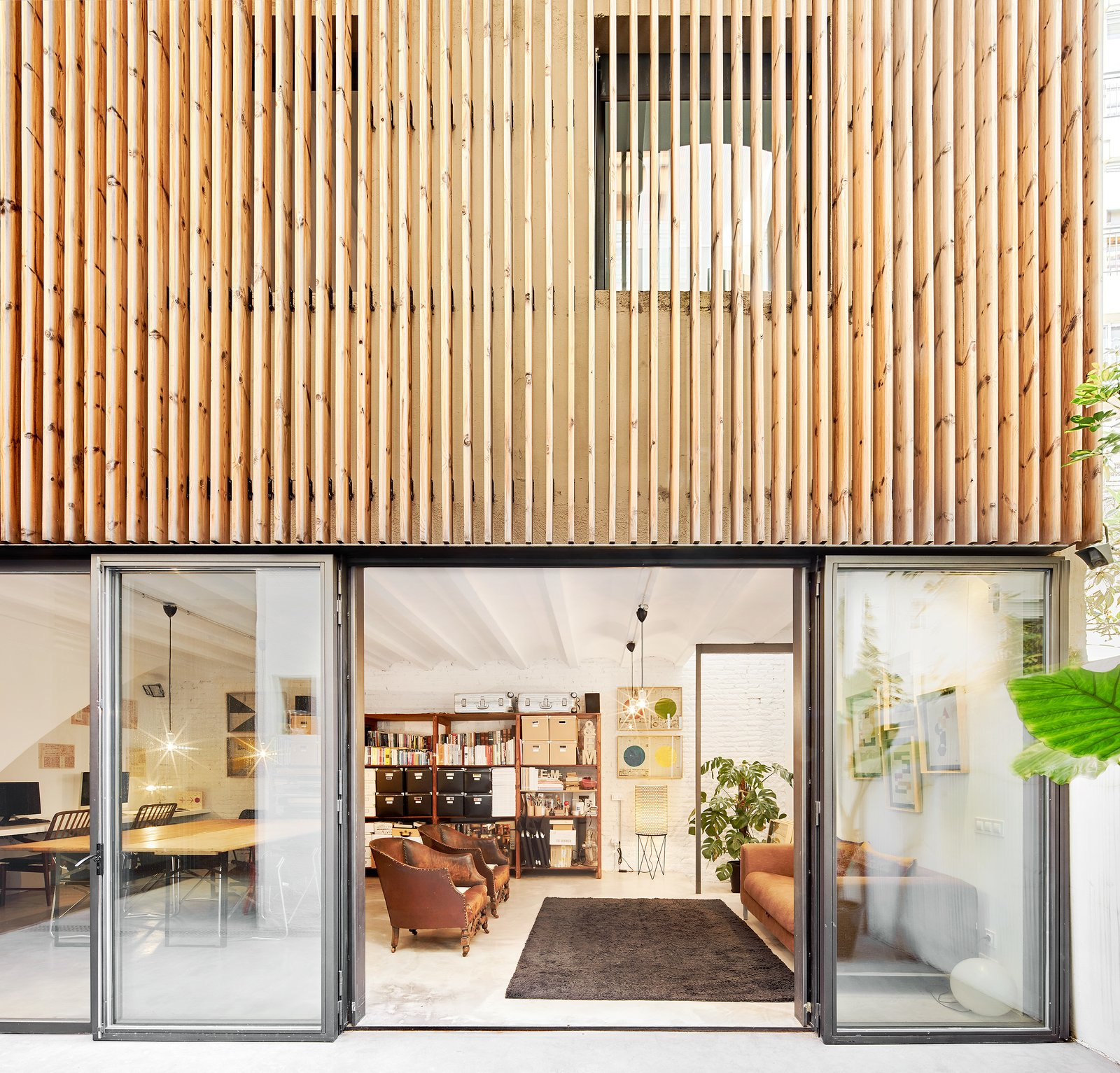 Conversion of a ground-floor publisher's warehouse into a residence and atelier for an artist-architect couple