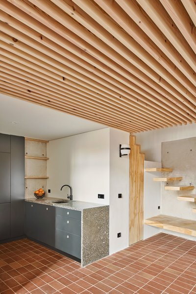 Dining room and kitchen with wood structural strips ceiling