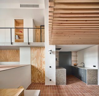 Dining, kitchen and living room with wood structural strips ceiling