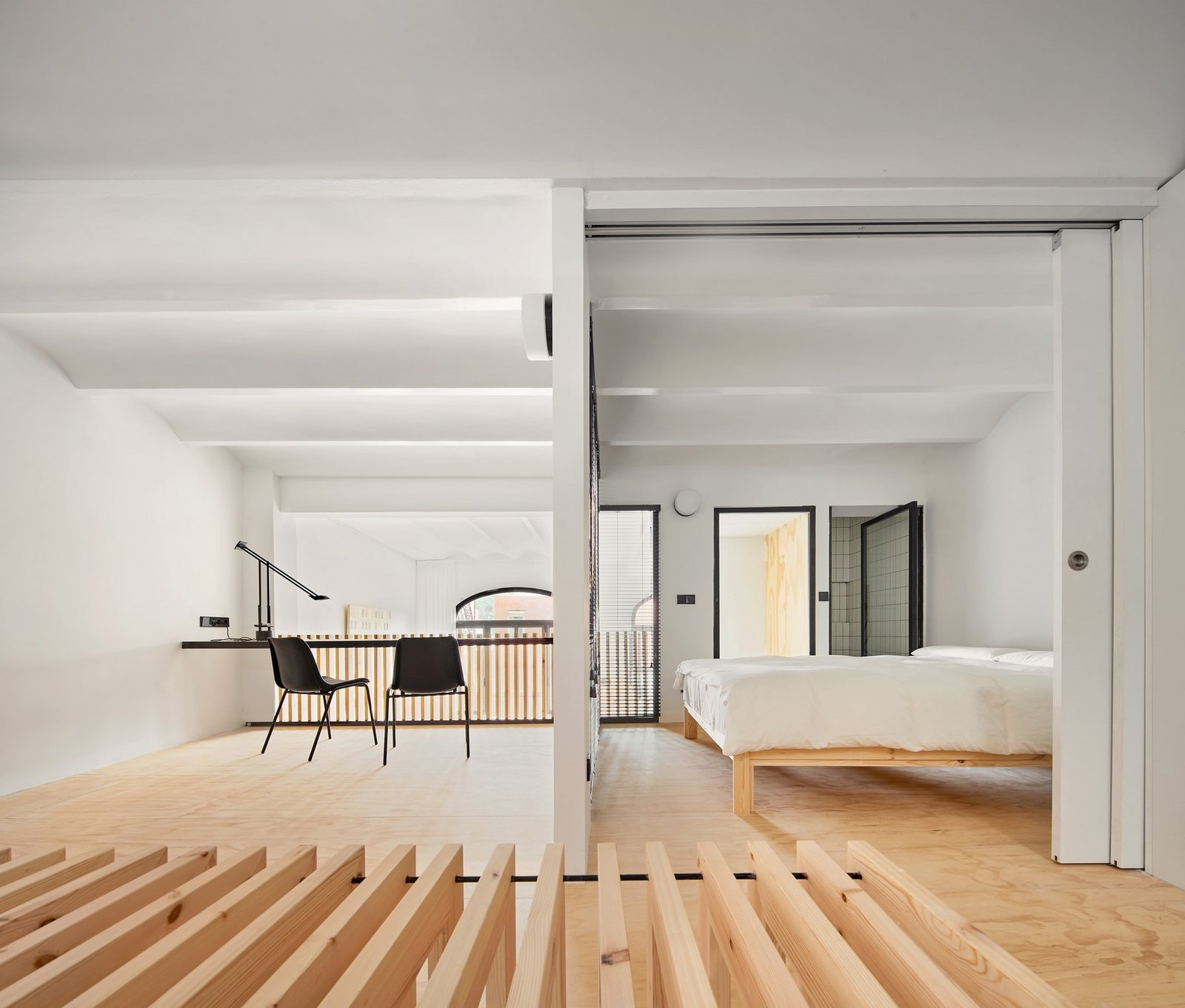 Bedroom, Lamps, Accent Lighting, Light Hardwood Floor, Bed, Chair, Wall Lighting, and Medium Hardwood Floor Bedroom and studio with wood strips bench  Photos from Yurikago House