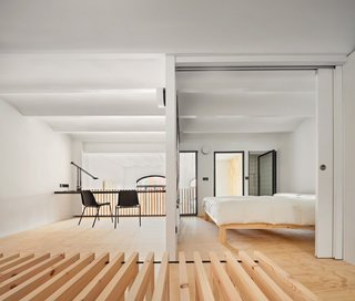 Bedroom and studio with wood strips bench