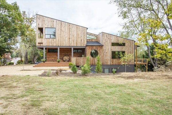 Locally milled cypress siding, a naturally rot-resistant wood, will darken over time.