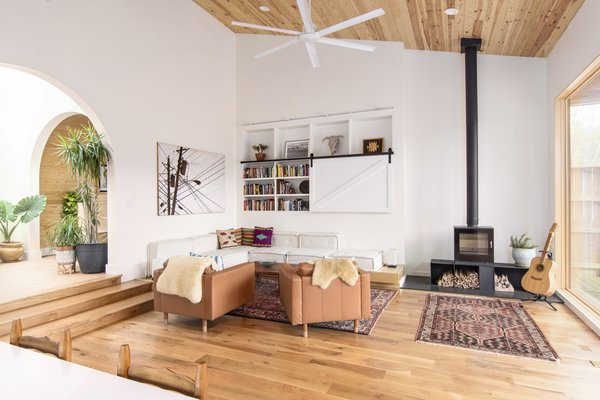 When not in use,  a TV is covered by a sliding barn door.