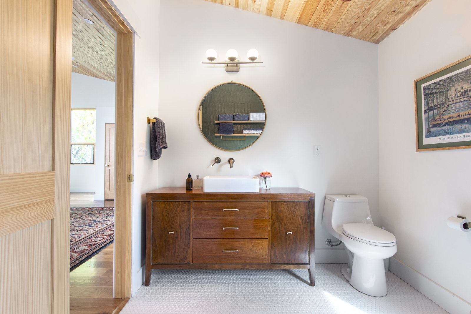 Bath Room, Open Shower, One Piece Toilet, Vessel Sink, Wall Lighting, Wood Counter, and Ceramic Tile Floor Vintage furniture used as a bath vanities saved on the budget.  Westwood House