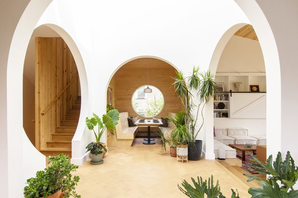 Arched entryways bring to mind the cave homes in Oia, Greece.