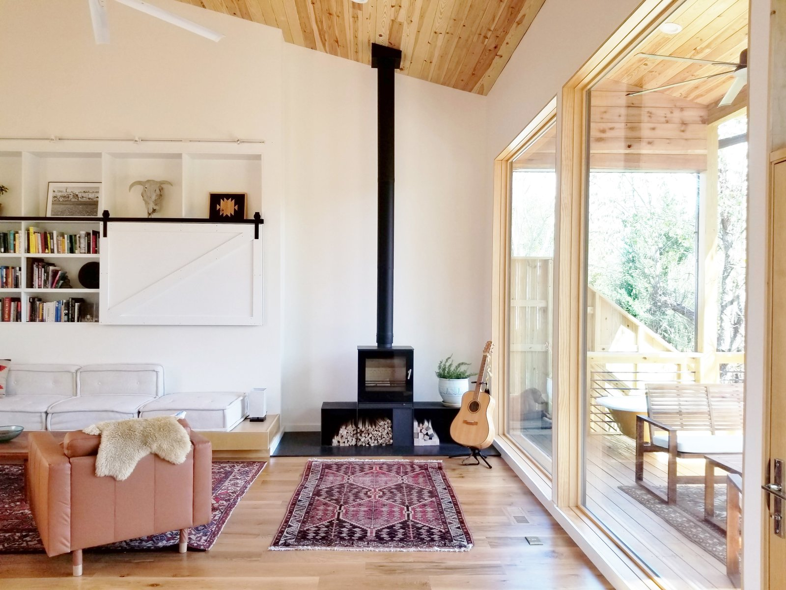 An energy-efficient, Danish wood-burning stove by Rais anchors one corner of the living room.   Westwood House