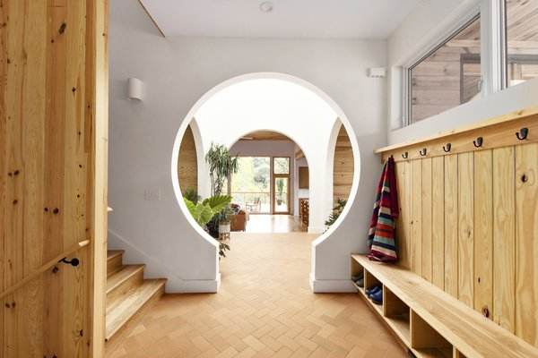 A keyhole doorway marks the boundary between public and private sides of the house.