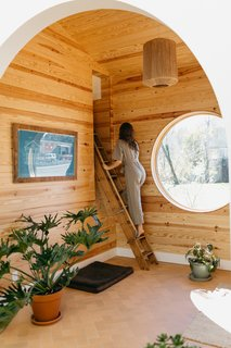 A ladder leads to the sleeping nook.