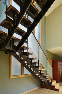 Steel and wood stair with textured glass railing