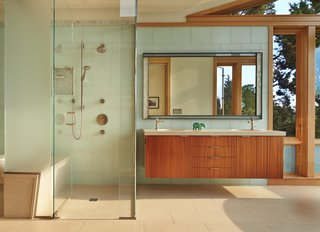 Master Bath with glass tile wall and sapele-wood suspended vanity
