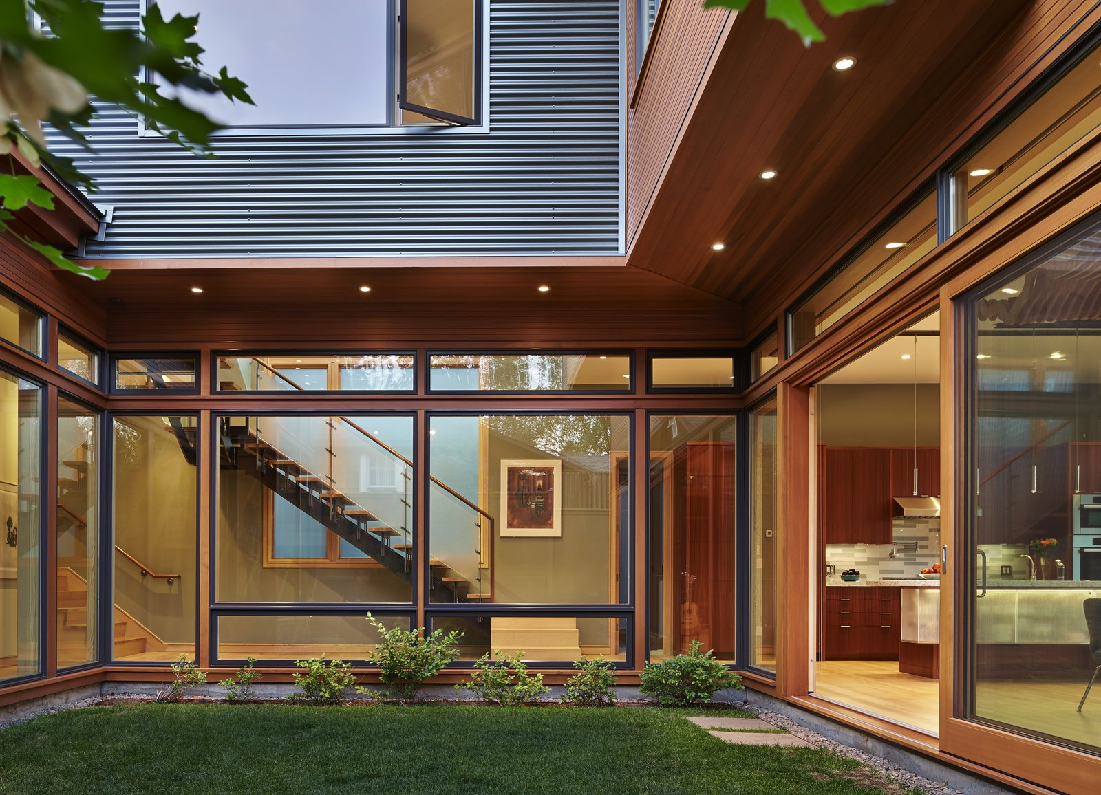 Exterior, Metal, Wood, Metal, Flat, and House View of courtyard  Best Exterior Metal House Flat Metal Photos from DESCHUTES House