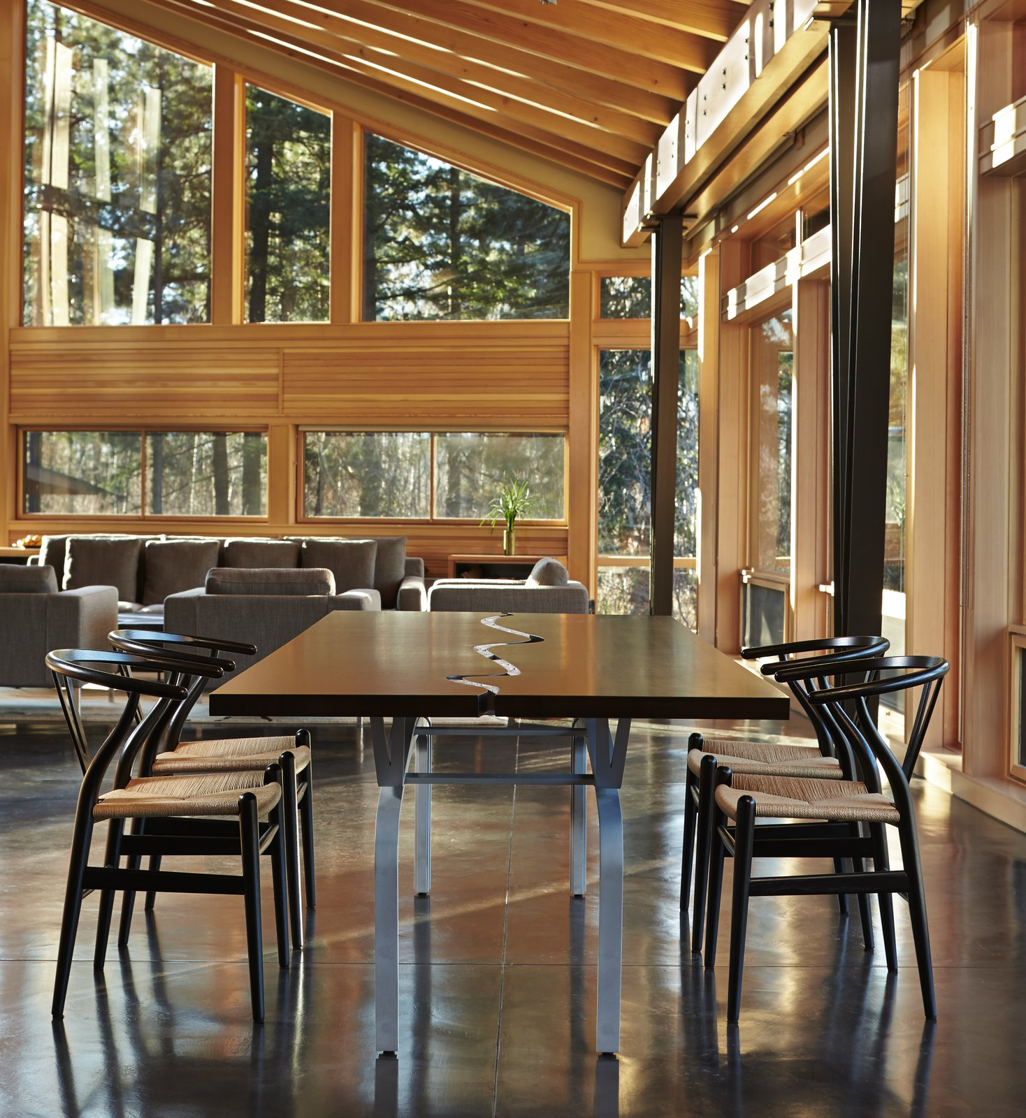 Dining Room, Chair, Table, Ceiling Lighting, Standard Layout Fireplace, and Concrete Floor Dining space with custom walnut and aluminum table  Quantum Signature Series Windows from Mazama House